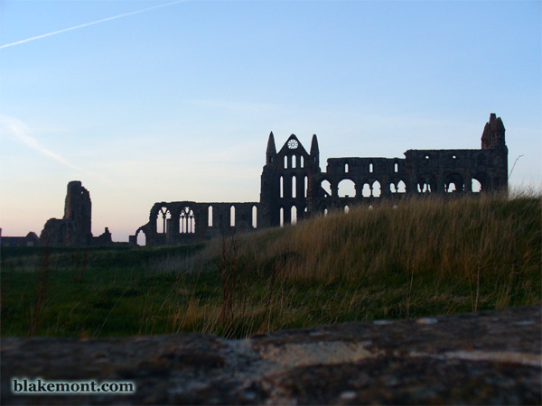 Ruins of Whitby Abbey in the sunset.