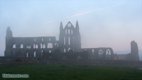 ruins of Whitby Abbey shrouded in fog