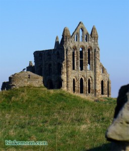 Gothic ruins of Whitby Abbey in the sunrise