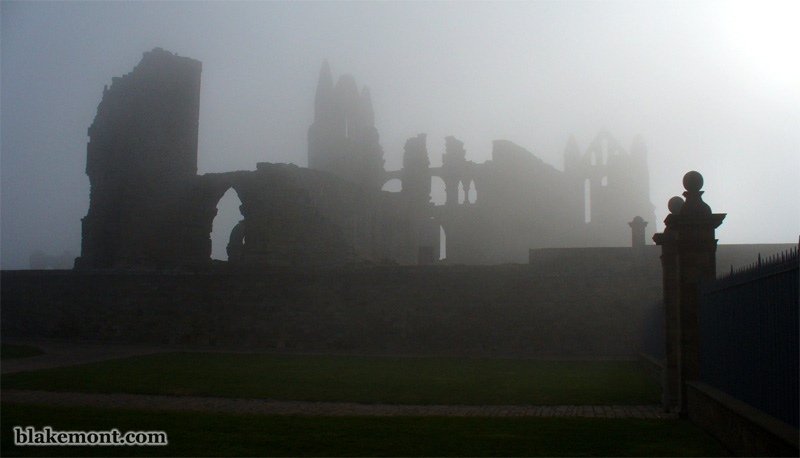 Gothic ruins of Whitby Abbey in the fog